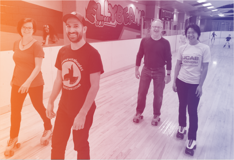 Unity team members, Alisa, Andy, Bud, and Angela rollerskating.