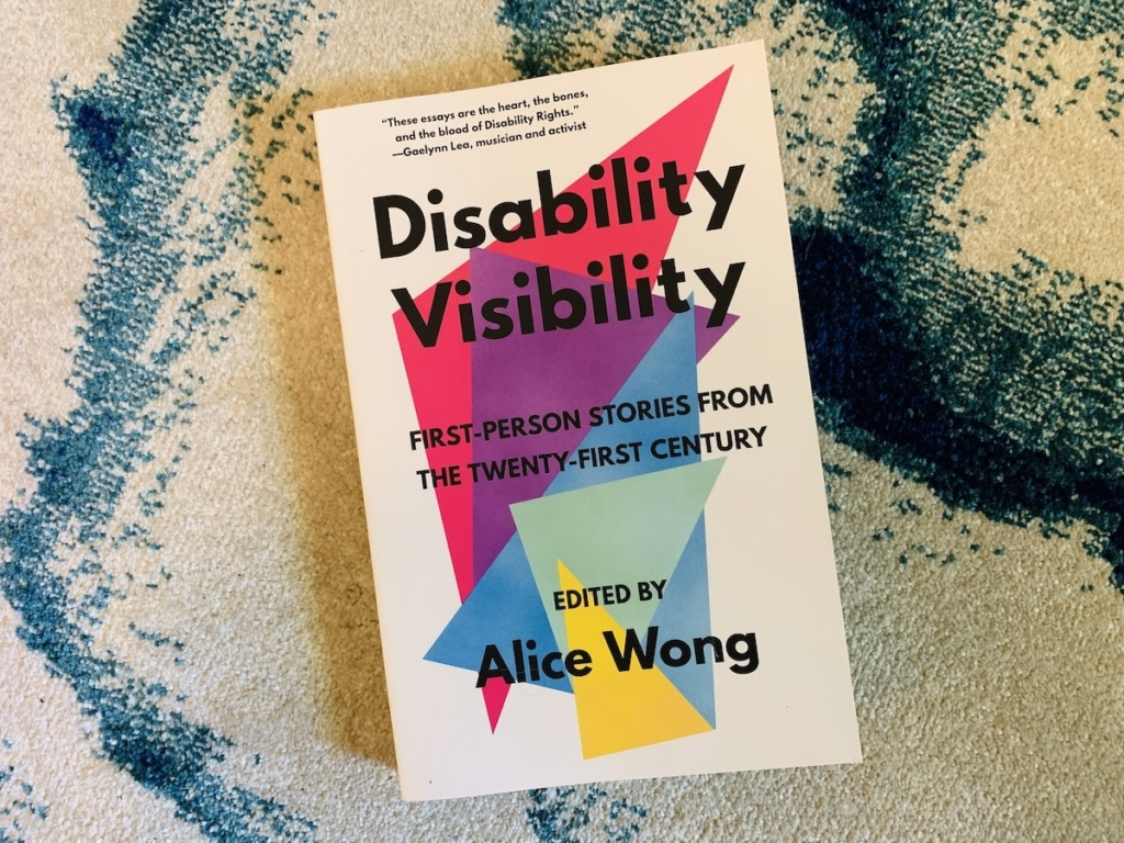 A physical copy of Disability Visibility: First Person Stories From The Twenty-First Century. Edited by Alice Wong.