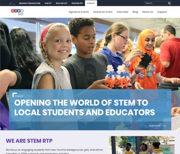 A website with a large photo of smiling school kids. The text says 'Opening the world of STEM to local students and educators.'