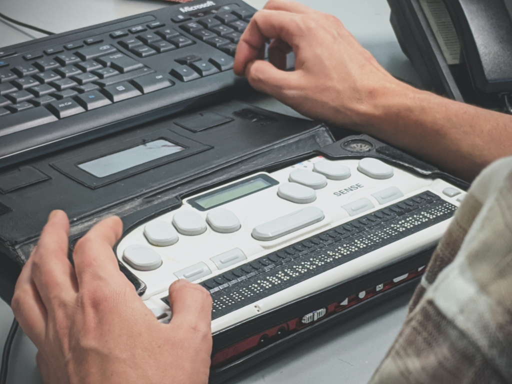 Person using a braille screen reader