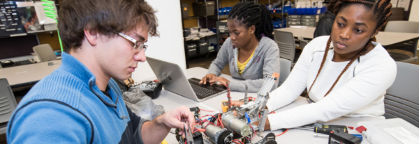 ECU undergraduate students working on a robotics project for their technology course.