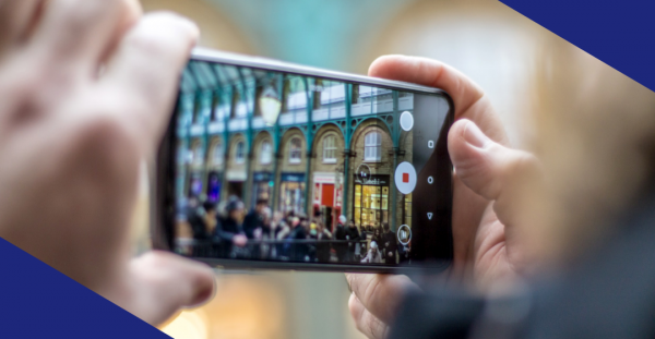 A person taking a photo with a smart phone