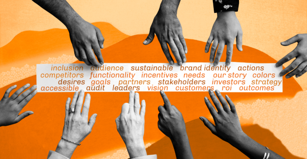 Hands coming together around a panel of common business words